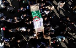 Relatives carry the coffin of British-Algerian journalist Mohamed Tamalt, British-Algerian journalist who had died six months after staging a hunger strike in Algiers over his detention for publishing articles seen as offensive to President Abdelaziz Bouteflika, during his funeral in Algiers, Algeria December 12, 2016.  REUTERS/ Ramzi Boudina