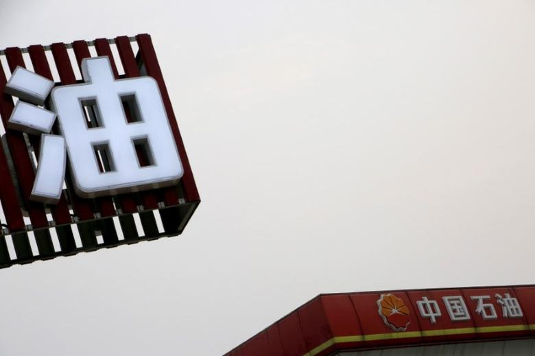 PetroChina's logo (R) is seen at its petrol station in Beijing, China | REUTERS