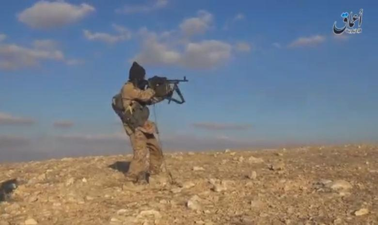 A still image taken from a video released by Islamic State-affiliated Amaq news agency, on December 11, 2016, purports to show an Islamic State fighter shooting near what is said to be Palmyra. Handout via REUTERS TV