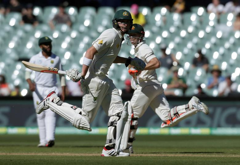 Cricket - Australia v South Africa - Third Test cricket match - Adelaide Oval, Adelaide, Australia - 27/11/16. Australian batsman David Warner (R) and Matthew Renshaw run down the pitch during the fourth day of the Third Test cricket match in Adelaide. REUTERS/Jason Reed