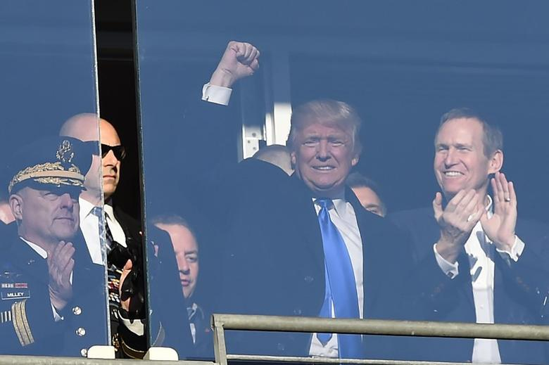 Dec 10, 2016; Baltimore, MD, USA;  United States of America president elect Donald Trump waves to the crowd from a suit during the first quarter of the 117 annual Army Navy game at M&T Bank Stadium. Mandatory Credit: Tommy Gilligan-USA TODAY Sports