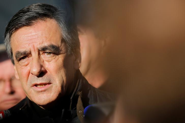 Francois Fillon, member of Les Republicains political party and 2017 presidential candidate of the French centre-right, talks to the media during a visit at a farm in Chantenay-Villedieu, western France, December 1, 2016. REUTERS/Stephane Mahe/Files