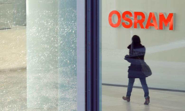 A woman walks in the headquarters of lamp manufacturer Osram in Munich, Germany February 26, 2014. REUTERS/Michaela Rehle/Files