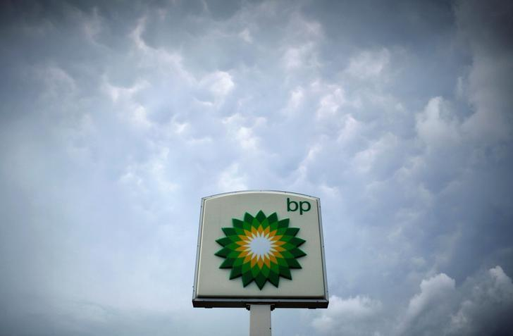 Storm clouds form near a BP station in Alexandria, Virginia July 19, 2010. REUTERS/Molly Riley/Files