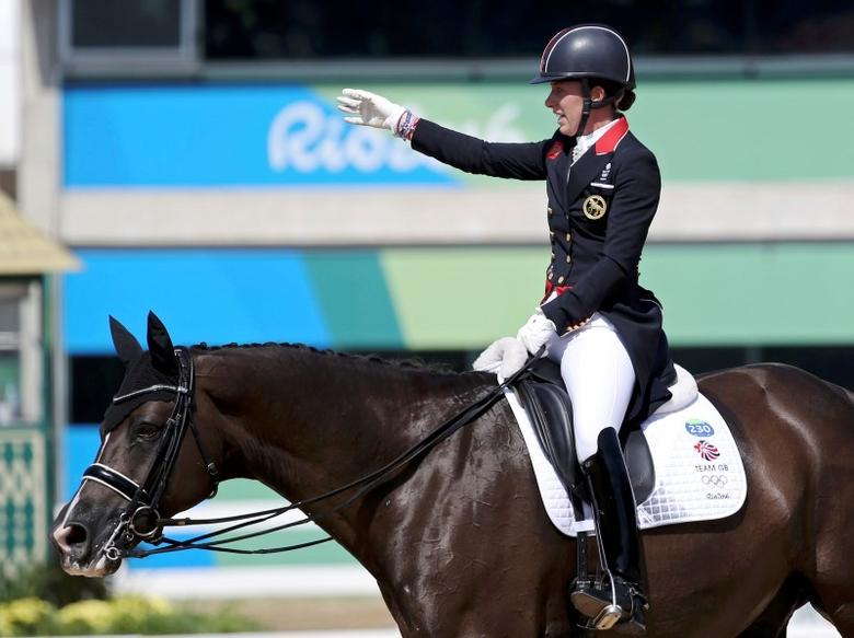 2016 Rio Olympics - Equestrian - Final - Dressage Individual Grand Prix Freestyle - Olympic Equestrian Centre - Rio de Janeiro, Brazil - 15/08/2016. Charlotte Dujardin (GBR) of Britain riding Valegro waves to fans. REUTERS/Tony Gentile