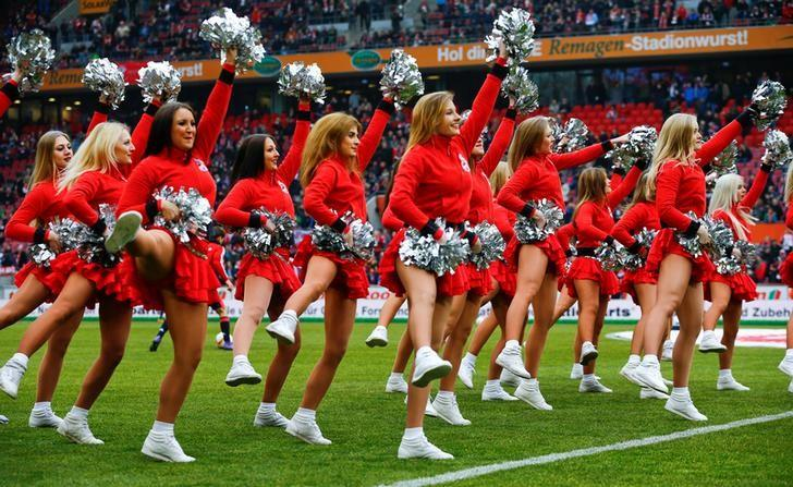 Cheerleaders of German first division team FC Cologne perform before a Bundesliga match of their team in Cologne, western Germany, March 19, 2016.       REUTERS/Wolfgang Rattay