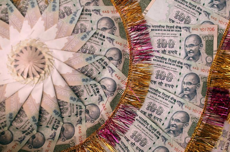 A garland made of Indian currency notes is pictured in a shop at a market in Jammu, India, November 13, 2016. REUTERS/Mukesh Gupta/File Photo