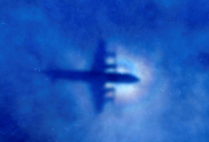 The shadow of a Royal New Zealand Air Force (RNZAF) P3 Orion maritime search aircraft can be seen on low-level clouds as it flies over the southern Indian Ocean looking for missing Malaysian Airlines flight MH370 March 31, 2014.   REUTERS/Rob Griffith/Pool/File Photo