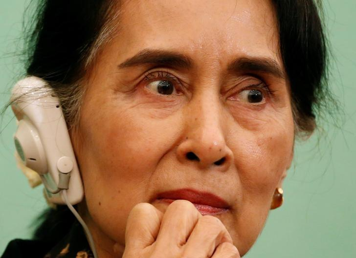 Myanmar State Counselor Aung San Suu Kyi listens to a reporter's question during a news conference at the Japan National Press Club in Tokyo, Japan November 4, 2016. REUTERS/Issei Kato/Files