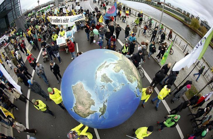 Protesters demonstrate during a rally held the day before the start of the Paris Climate Change Summit in Berlin, Germany, November 29, 2015. REUTERS/Pawel Kopczynski/File Photo