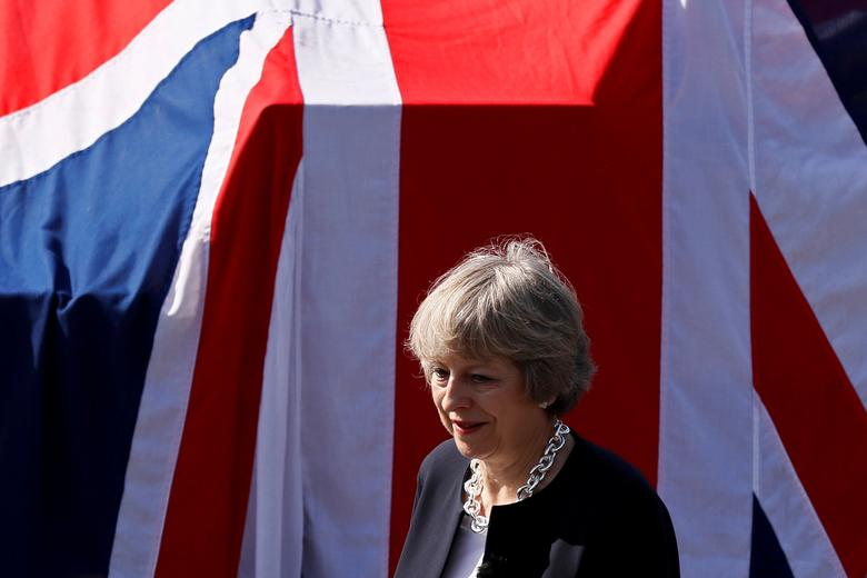 Britain's Prime Minister Theresa May waits to address sailors on deck of HMS Ocean in Manama, Bahrain December 6, 2016. REUTERS/Stefan Wermuth/File Photo