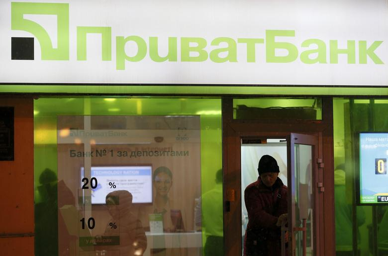 A man leaves a branch of Privatbank in Kiev, Ukraine December 14, 2016. REUTERS/Valentyn Ogirenko