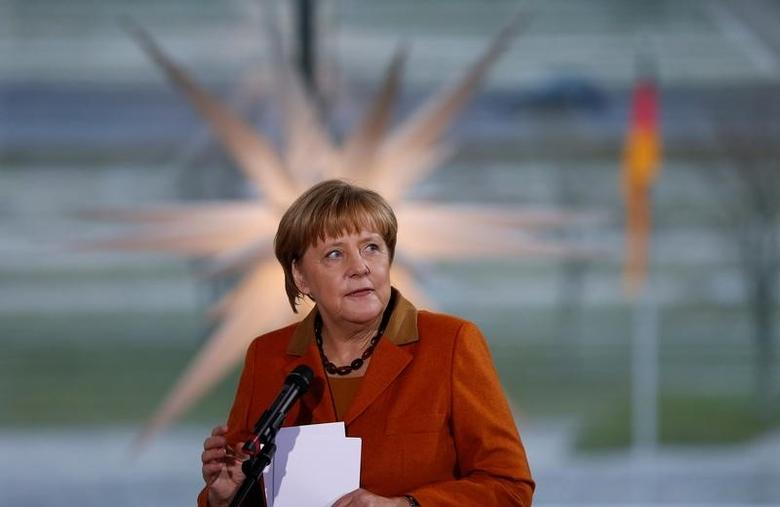 German Chancellor Angela Merkel speaks to relatives of Bundeswehr soldiers and police officers deployed abroad, at the Chancellery in Berlin, Germany, December 14, 2016. REUTERS/Hannibal Hanschke