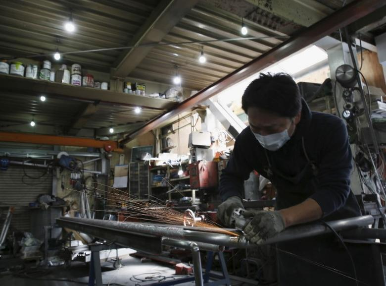 An engineer makes an arm rail for residential buildings inside a metal processing factory at an industrial zone in downtown Tokyo, Japan, March 22, 2016.  REUTERS/Yuya Shino