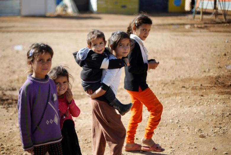 Syrian refugee children play at Al Zaatari refugee camp in Jordan near the border with Syria, December 3, 2016. REUTERS/Muhammad Hamed/Files