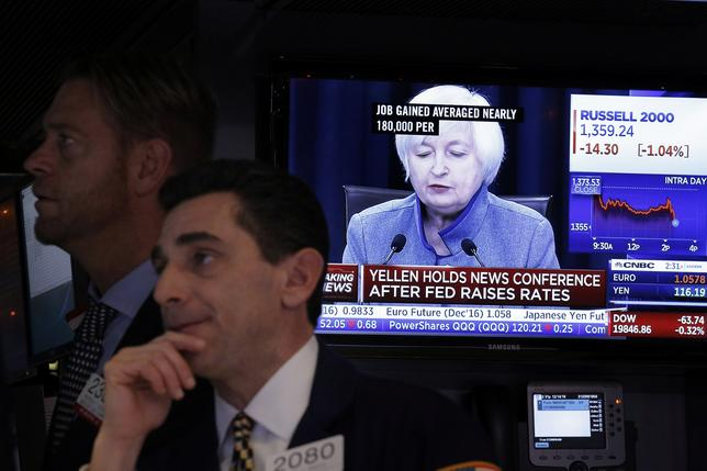Traders works on the floor of the New York Stock Exchange (NYSE) as a television screen displays coverage of U.S. Federal Reserve Chairman Janet Yellen shortly after the announcement that the U.S. Federal Reserve will hike interest rates, in New York, U.S., December 14, 2016.  REUTERS/Lucas Jackson