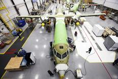 FILE PHOTO - A Bombardier q400 airplane is seen being assembled at the Bombardier aircraft manufacturing facility in Toronto, November 25, 2010. REUTERS/Mark Blinch