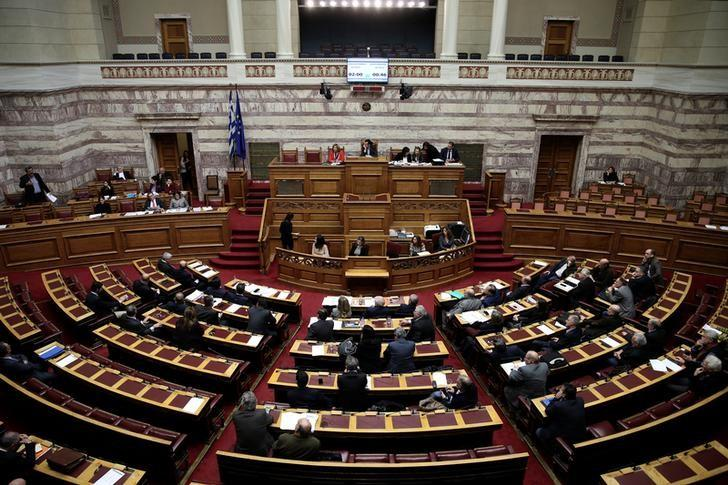 Greek lawmakers attend a parliamentary session before a vote on a one-off benefit approved to pensioners in Athens, Greece, December 15, 2016. REUTERS/Alkis Konstantinidis