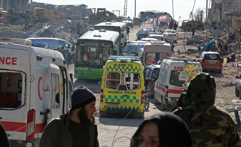 Ambulances and buses wait as they evacuate people from a rebel-held sector of eastern Aleppo, Syria December 15, 2016. REUTERS/Abdalrhman Ismail