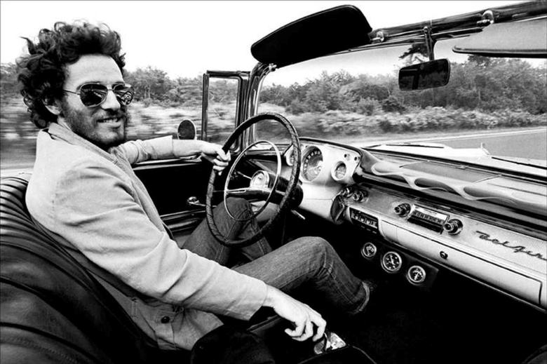 Recording artist Bruce Springsteen is shown driving his 1957 Chevrolet Bel Air Convertible in this undated photo, referenced in his iconic song ''Born to Run'' which is up for auction and is expected to fetch several hundred thousand dollars, provided December 15, 2016.    Courtesy Eric Meola/Handout via REUTERS