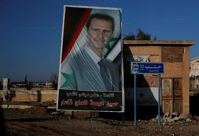 A picture of Syria's President Bashar al-Assad is seen in Ramouseh, a government controlled area of Aleppo, Syria December 8, 2016.   REUTERS/Omar Sanadiki/Files