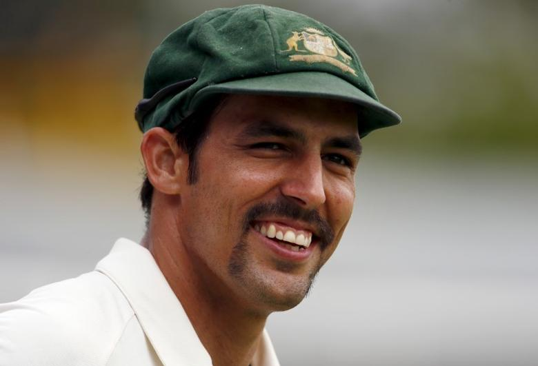 Australia's Mitchell Johnson smiles towards a member of the crowd as he fields near the boundary during the fifth day of the second cricket test match against New Zealand at the WACA ground in Perth, Western Australia, November 17, 2015.    REUTERS/David Gray/Files