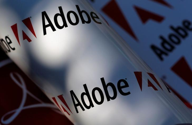 Adobe company logos are seen in this picture illustration taken in Vienna July 9, 2013. Picture taken July 9, 2013.     REUTERS/Leonhard Foeger/File Photo
