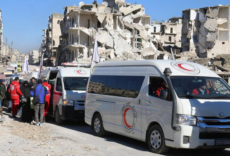 Ambulances wait as they evacuate people from al-Sukkari rebel-held sector of eastern Aleppo, Syria December 15, 2016. REUTERS/Abdalrhman Ismail
