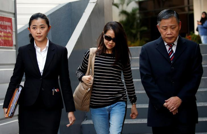 Former BSI banker Yvonne Seah Yew Foong, with her lawyer Peter Low, leaves the State Courts in Singapore October 10, 2016. REUTERS/Edgar Su