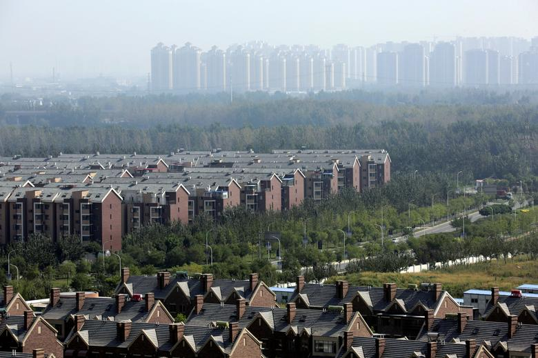 Apartment blocks and villas (bottom) are pictured in Wuqing District of Tianjin, China September 10, 2016.  REUTERS/Jason Lee