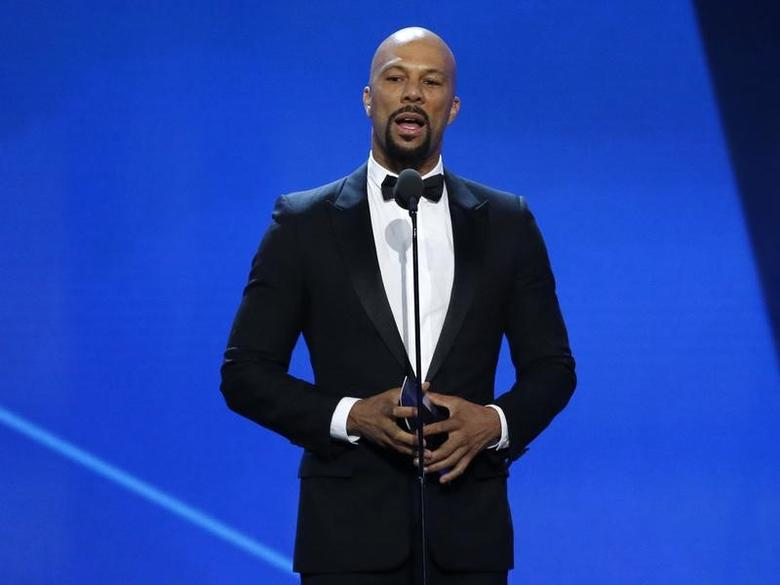 Rapper Common presents the best song award at the 22nd Annual Critics' Choice Awards in Santa Monica, California, U.S., December 11, 2016.  REUTERS/Mario Anzuoni