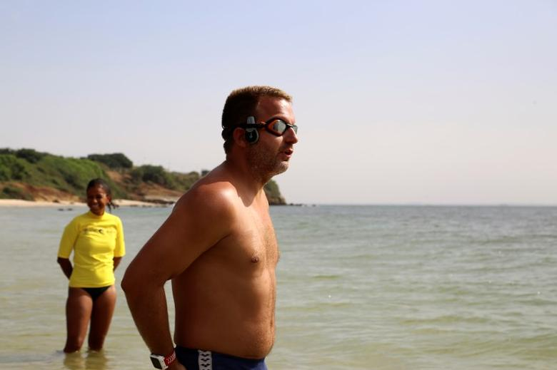 Ben Hooper, 38, looks out to sea before starting a swim across the Atlantic from Dakar, Senegal, November 13, 2016. REUTERS/Emma Farge