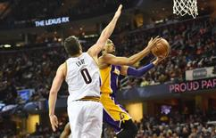 Dec 17, 2016; Cleveland, OH, USA; Los Angeles Lakers guard Jordan Clarkson (6) drives to the basket against Cleveland Cavaliers forward Kevin Love (0) during the first half at Quicken Loans Arena. The Cavs won 119-108. Mandatory Credit: Ken Blaze-USA TODAY Sports