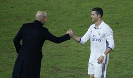 Football Soccer - Real Madrid v Kashima Antlers - FIFA Club World Cup Final - International Stadium Yokohama - Japan , 18/12/16 Real Madrid's Cristiano Ronaldo with Real Madrid coach Zinedine Zidane after being substituted Reuters / Issei Kato Livepic