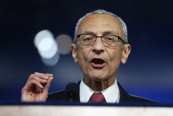 John Podesta, chairman of the 2016 Hillary Clinton presidential campaign, addresses the crowd at Democratic U.S. presidential nominee Hillary Clinton's election night rally in New York, U.S., November 9, 2016. REUTERS/Carlos Barria/Files