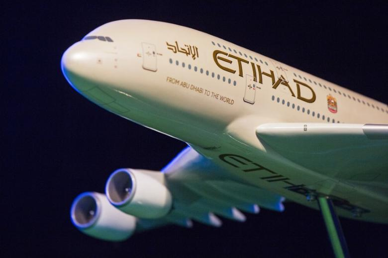 A model Etihad Airways plane is seen on stage before the unveiling of the new home jersey for the New York City Football Club in New York November 13, 2014.  REUTERS/Lucas Jackson