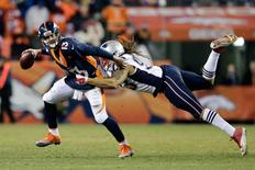 Dec 18, 2016; Denver, CO, USA; Denver Broncos quarterback Trevor Siemian (13) looks to throw the ball under pressure from New England Patriots defensive end Jabaal Sheard (93) in the fourth quarter at Sports Authority Field at Mile High. The Patriots won 16-3. Mandatory Credit: Isaiah J. Downing-USA TODAY Sports