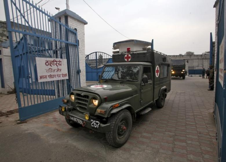 Indian army's ambulance enters inside the Indian Air Force (IAF) base at Pathankot in Punjab, India, January 4, 2016.  REUTERS/Mukesh Gupta