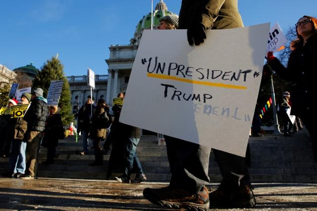People protest against U.S. President-elect Donald Trump as electors gather to cast their votes for U.S. president at the Pennsylvania State Capitol in Harrisburg, Pennsylvania, U.S. December 19, 2016. REUTERS/Jonathan Ernst