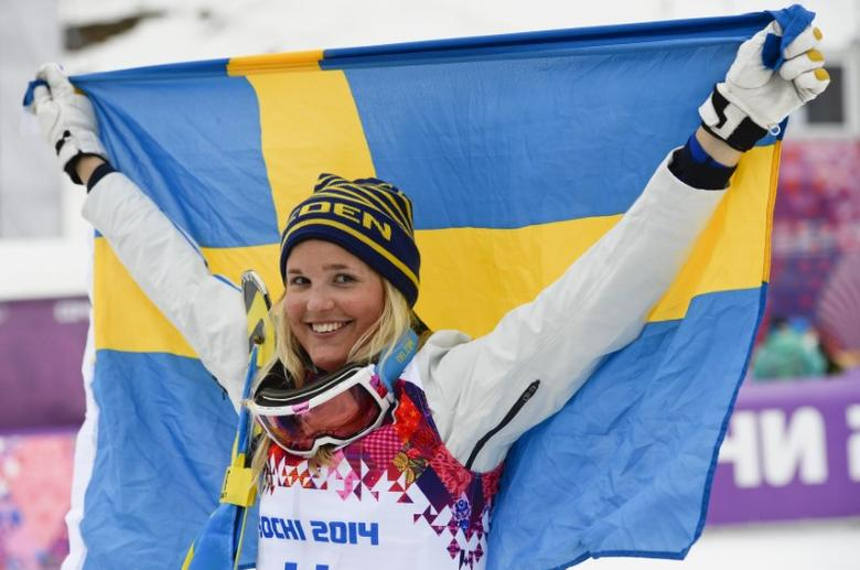 Sweden's third placed Anna Holmlund celebrates after the women's freestyle skiing skicross finals at the 2014 Sochi Winter Olympic Games in Rosa Khutor, February 21, 2014.              REUTERS/Dylan Martinez