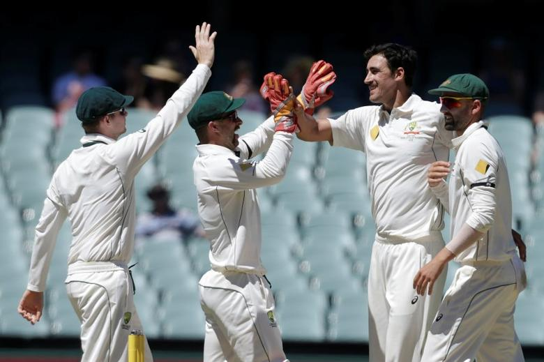 Cricket - Australia v South Africa - Third Test cricket match - Adelaide Oval, Adelaide, Australia - 27/11/16. Australian bowler Mitchell Starc (2nd R) celebrates the dismissal of South Africa's Vernon Philander with team mates (L-R) Steve Smith, Matthew Wade and Nathan Lyon during the fourth day of the Third Test cricket match in Adelaide.   REUTERS/Jason Reed