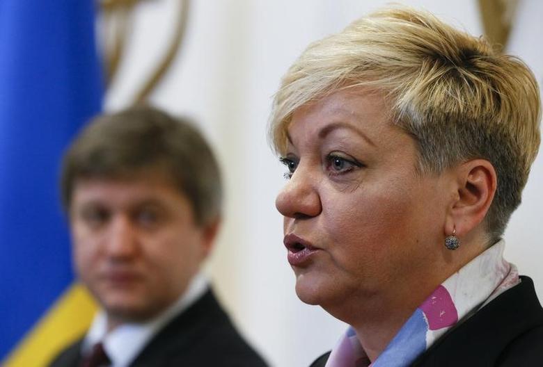 Ukraine's Finance Minister Oleksandr Danylyuk (L) and Central Bank Governor Valeriia Gontareva attend a news conference in Kiev, Ukraine, December 19, 2016. REUTERS/Valentyn Ogirenko