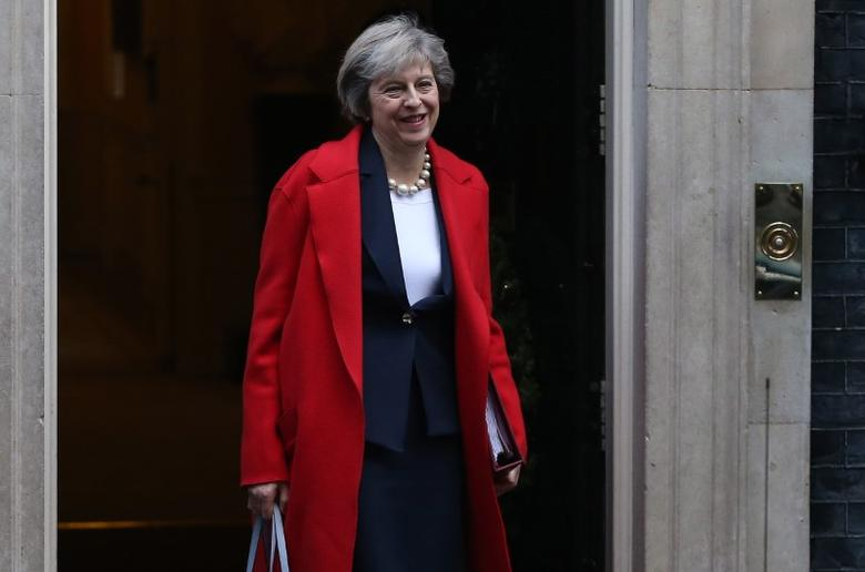 Britain's Prime Minister Theresa May leaves Downing Street in London to attend her final Prime Minister's Question Time of 2016, Britain December 14, 2016. REUTERS/Neil Hall