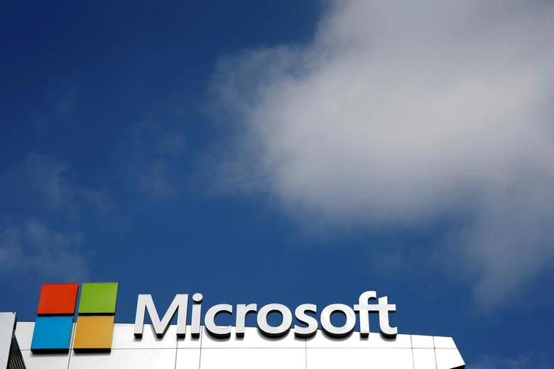 A Microsoft logo is seen next to a cloud in Los Angeles, California, U.S. on June 14, 2016.   REUTERS/Lucy Nicholson/File Photo