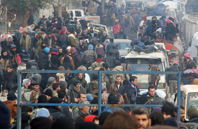 Rebel fighters and civilians gather as they wait to be evacuated from a rebel-held sector of eastern Aleppo, Syria December 16, 2016. REUTERS/Abdalrhman Ismail