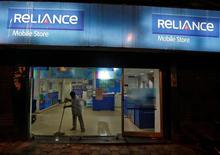 A worker cleans a mobile store of Reliance Communications Ltd, controlled by billionaire Anil Ambani, in Kolkata, India, September 10, 2016. REUTERS/Rupak De Chowdhuri