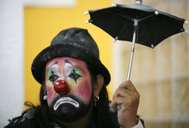A clown looks on during a news conference in Mexico City October 14, 2009. REUTERS/Eliana Aponte