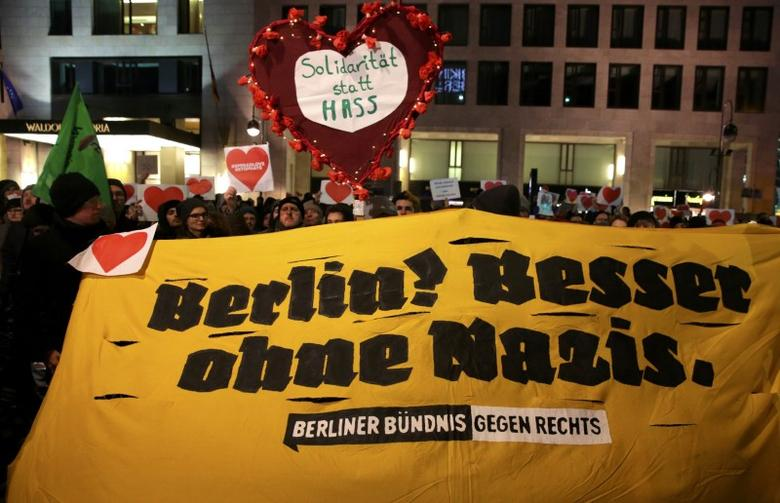 Demonstrators protest against a right wing demonstration at the Kaiser-Wilhelm-Gedaechtniskirche (Kaiser Wilhelm Memorial Church), in Berlin, Germany, December 21, 2016, after a truck ploughed through a crowd at a Christmas market in the captial on Monday night. Sign in front reads ''Berlin! Better without nazis''.  REUTERS/Christian Mang