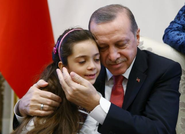 Turkish President Tayyip Erdogan meets with Syrian girl Bana Alabed, known as Aleppo's tweeting girl, at the Presidential Palace in Ankara, Turkey, December 21, 2016. Kayhan Ozer/Presidential Palace/Handout via REUTERS