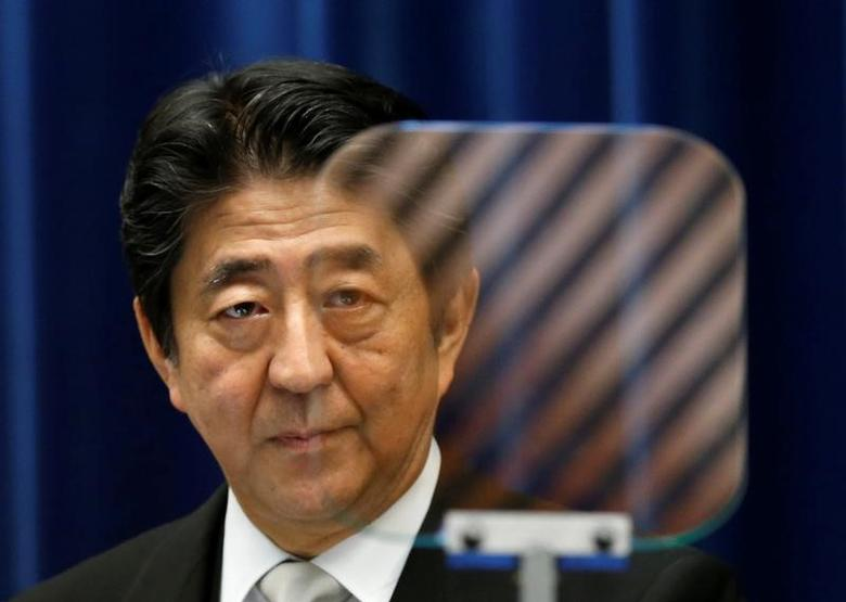 Japan's Prime Minister Shinzo Abe is seen through a prompter as he speaks at a news conference at his official residence in Tokyo, Japan, August 3, 2016. REUTERS/Kim Kyung-Hoon